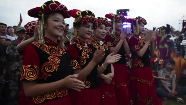 vídeos de stock, filmes e b-roll de traditionally an occasion for matchmaking the torch festival in xichang has become an occasion for the yi people of southwestern sichuan province to... - cupido
