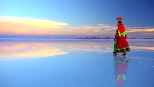 traditionally dressed female on bolivian salar de uyuni - bolivia stock videos & royalty-free footage