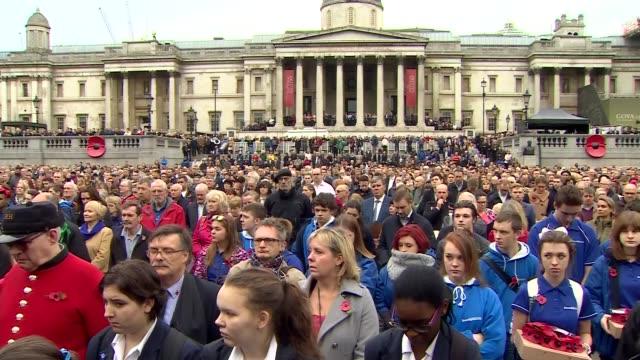 trafalgar square armistice day commemoration crowd observe minute's silence - armistice stock videos & royalty-free footage
