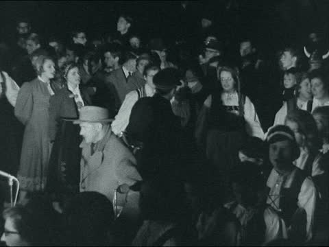 trafalgar square christmas tree lights switched on; ** digitised version of fs151261007 ** england: london: trafalgar square: ext / night crowd... - traditionally norwegian stock videos & royalty-free footage