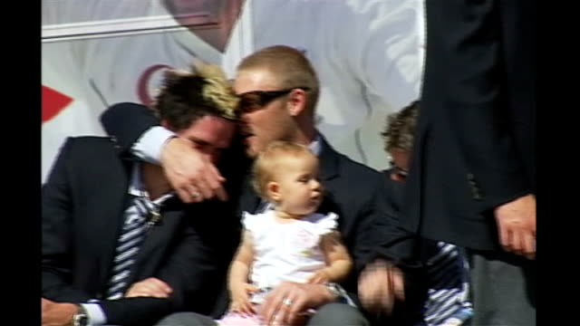 EXT Flintoff sitting with daughter on his lap as hugging teammate Kevin Pietersen during 2005 Ashes celebration