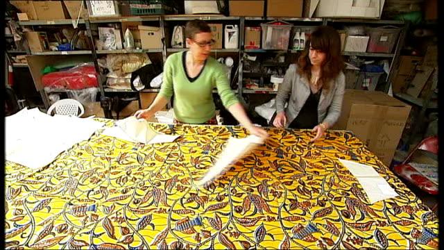 giant 'ship in bottle' sculpture east london assistants preparing batik material for hms victory model's sails - batik stock videos and b-roll footage