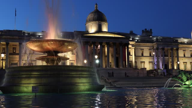 trafalgar square is illuminated in yellow across the river thames on march 23, 2021 in london, united kingdom. the marie curie cancer charity has... - tranquility stock videos & royalty-free footage