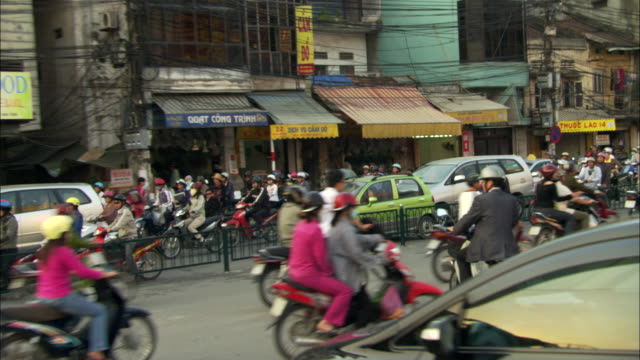a traffic accident on a busy hanoi street obstructs the flow of traffic during rush hour. - vietnam stock videos & royalty-free footage