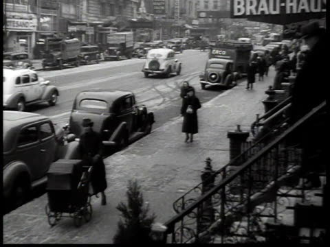 1938 ha traffic along 86th street in new york city's german-american neighborhood, with sign for the brau-haus / new york, usa - german culture stock videos & royalty-free footage