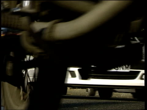 stockvideo's en b-roll-footage met ext traffic along road car pulling away from curb int car dutch driver along with dummy in backseat - passagiersstoel