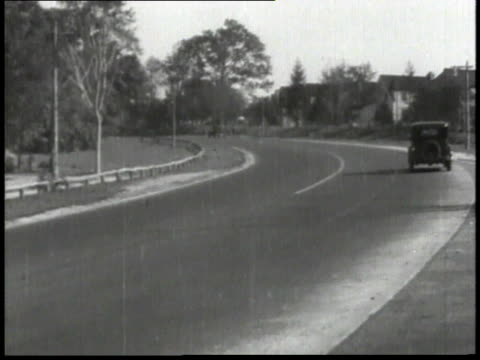 1932 montage traffic along roads / new york, united states - 1932 stock-videos und b-roll-filmmaterial