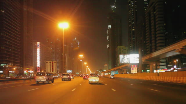 WS POV Traffic along Sheikh Zayed Road at night / Dubai, United Arab Emirates