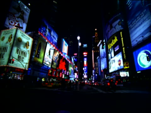 traffic and brightly illuminated billboards at night, time square, new york, usa - unknown gender stock videos & royalty-free footage