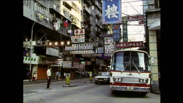 ws traffic and tu building in city street in hong kong; 1989 - banner stock videos & royalty-free footage