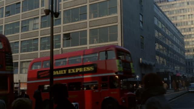 1968 montage traffic and buildings along fleet street / london, england - fleet street stock videos & royalty-free footage