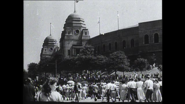 traffic and crowds of spectators approach the original wembley stadium for the 1948 london summer olympic games. - wembley stadium stock videos & royalty-free footage