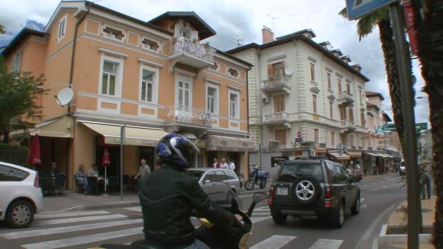 WS Traffic and crowds passing by luxury hotel / Opatija, Croatia