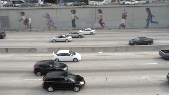 traffic and paintings of children on highway 101 in downtown la near city hall, los angeles, california, united states of america, north america - male likeness stock videos & royalty-free footage