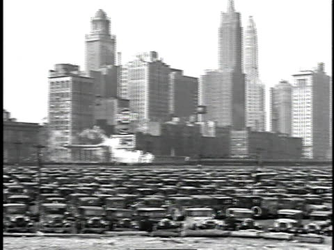 1929 MONTAGE Traffic and parked cars in large city / Chicago, Illinois, United States