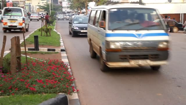 traffic and pedestrian shots of kampala - kampala stock-videos und b-roll-filmmaterial