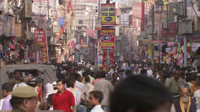 traffic and pedestrians congest a street in  india. - india stock videos & royalty-free footage