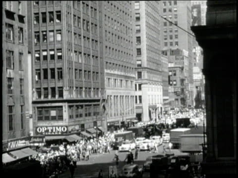 traffic and pedestrians crowd 7th avenue in new york city, new york. - 7th avenue stock videos & royalty-free footage