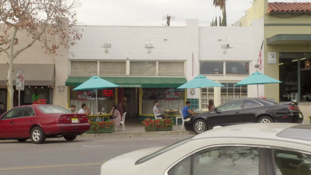 stockvideo's en b-roll-footage met ds traffic and pedestrians going by store fronts / sierra madre, california, united states - sierra madre