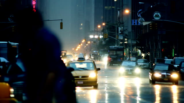 traffic and pedestrians make their way across wet new york city streets. - wet wet wet stock videos & royalty-free footage