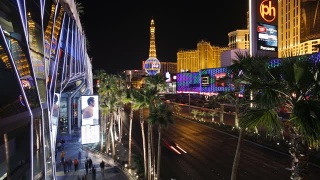 Traffic and pedestrians move along Las Vegas Boulevard near Planet Hollywood.