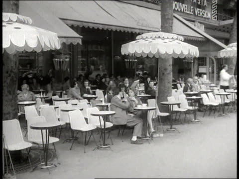 traffic and pedestrians move near the eiffel tower and the arc de triomphe in paris - 1958 stock videos & royalty-free footage