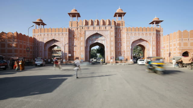 Traffic and pedestrians move through the Ajmeri Gate in the pink city of Jaipur, Rajasthan, India