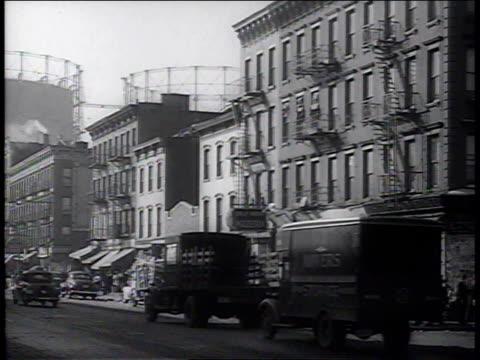 1941 ws traffic and pedestrians moving down little italy street / new york, new york, united states - 1940~1949年点の映像素材/bロール