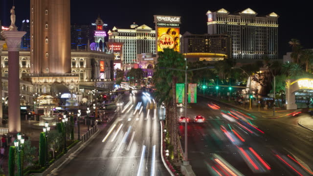 ws t/l traffic and pedestrians moving on street, hotel buildings in background / las vegas, nevada, united states  - the mirage las vegas stock videos & royalty-free footage