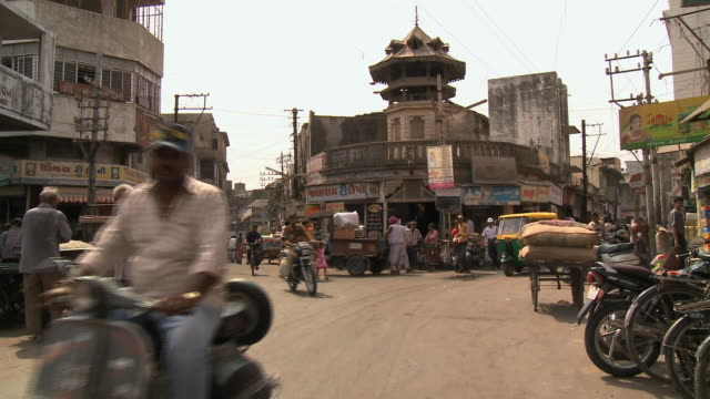 WS PAN Traffic and pedestrians on busy street / Rajkot, India