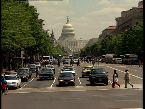 traffic and pedestrians on capitol hill with us capitol building in background - 1994 stock videos and b-roll footage