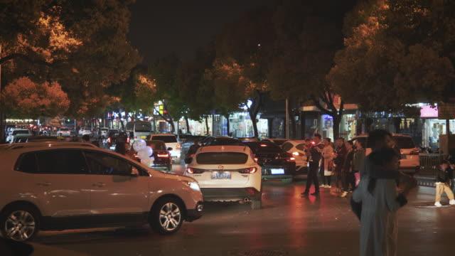 ws traffic and pedestrians on shantang street at night, suzhou, jiangsu province, china - east china stock videos & royalty-free footage