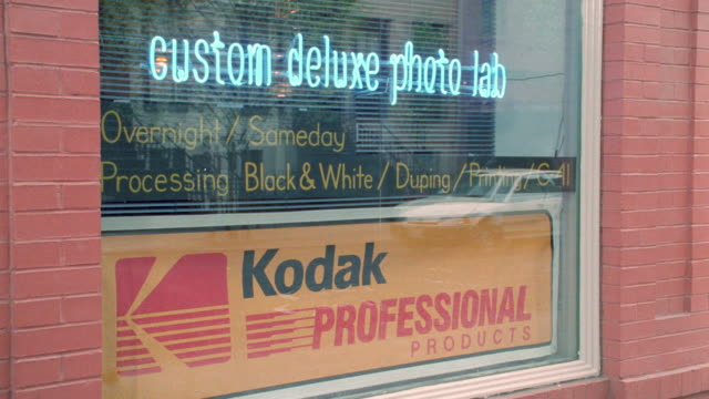 traffic and pedestrians reflect in the window of a new york city photo lab. - 1995 stock videos & royalty-free footage