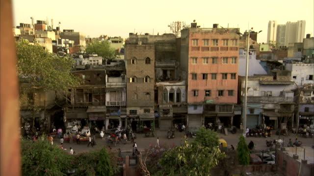 traffic and pedestrians stream through delhi, india. - delhi stock videos & royalty-free footage