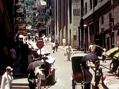 1939 ws traffic and people at busy intersection/ hong kong  - 1939 stock-videos und b-roll-filmmaterial
