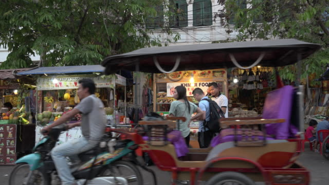 pan / traffic and people at food stall at street market at night in siem reap town - street food stock videos & royalty-free footage