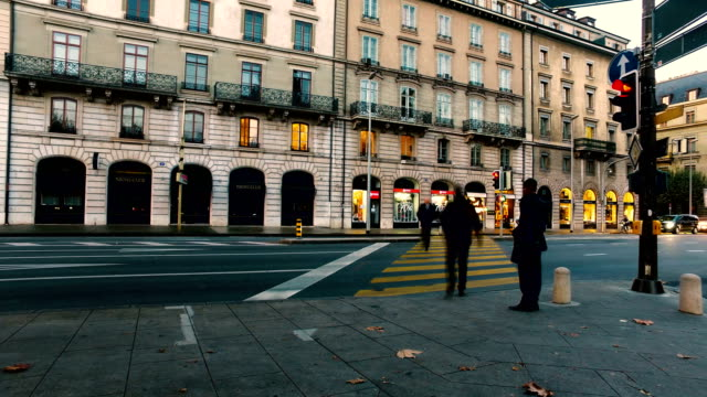 traffic and people blurred on the streets of geneva. - panning stock videos & royalty-free footage