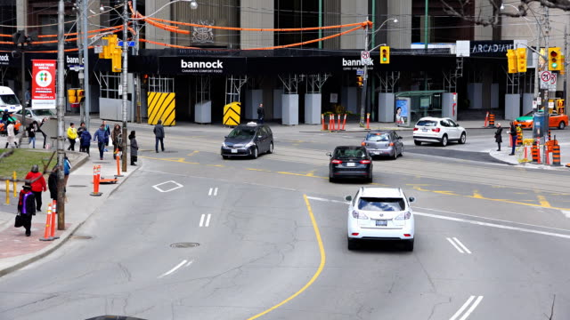 traffic and people in the queen st. west and bay st. intersection - 1 minute or greater stock videos & royalty-free footage
