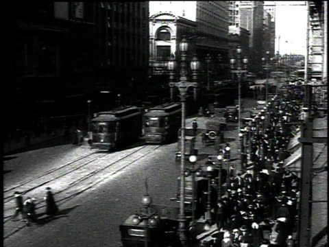 1916 montage traffic and people moving quickly around the city / san francisco, california, united states - san francisco california stock-videos und b-roll-filmmaterial