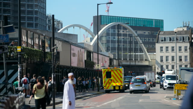 traffic and people pass shoreditch high st bridge - ambulance stock videos & royalty-free footage