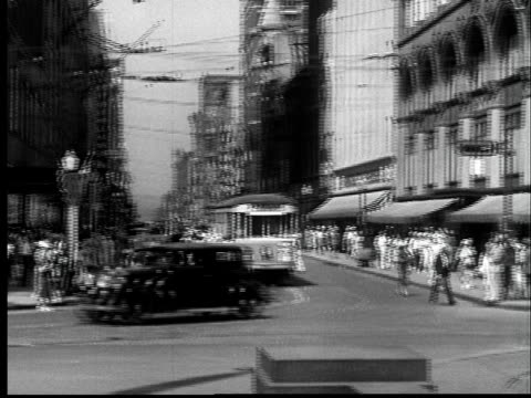 """""""1937 WS Traffic and people passing through busy intersection/ Cincinnati, Ohio"""""""