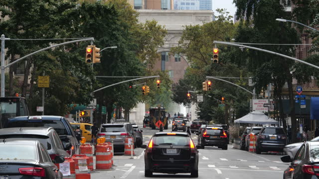 traffic and people wearing face mask walking with the washington square park in distance in new york city in the autumn amid the 2020 global... - bumpy stock videos & royalty-free footage
