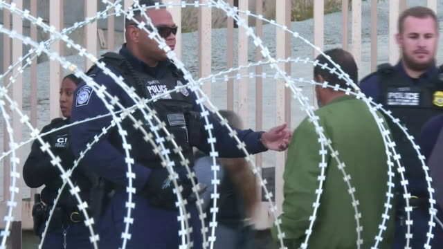 traffic and police at a usmexico border point in tijuana - blocco stradale video stock e b–roll