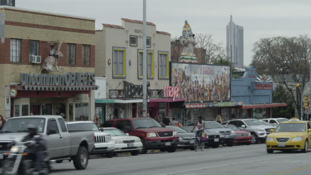 ms traffic and storefronts on south congress ave in austin - austin texas stock videos & royalty-free footage