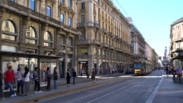 Traffic and streetcar downtown Milan.