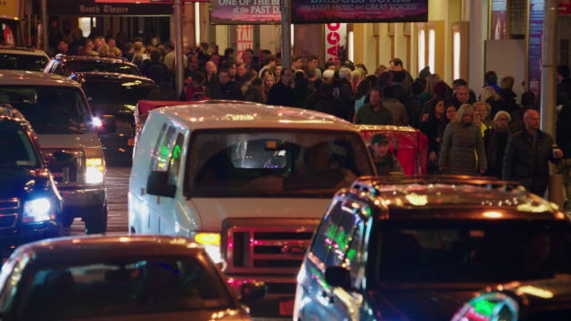 ms traffic and theatergoers moving through the broadway theater district / new york city, new york, united states - broadway manhattan stock videos and b-roll footage