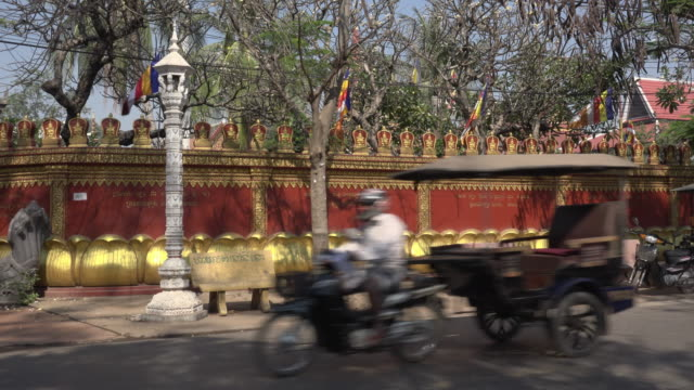 Traffic and tourists at Wat Preah Prom Rath temple in Siem Reap