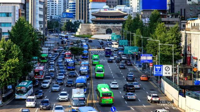 traffic around namdaemun (sungnyemun) gate / jung-gu, seoul, south korea - crossroad stock videos & royalty-free footage