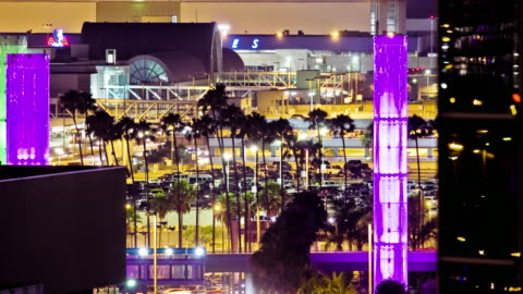 ws t/l traffic around parking lots at los angeles international airport with terminal buildings in background and kinetic light installation translucent pylons / los angeles, california - translucent stock videos & royalty-free footage