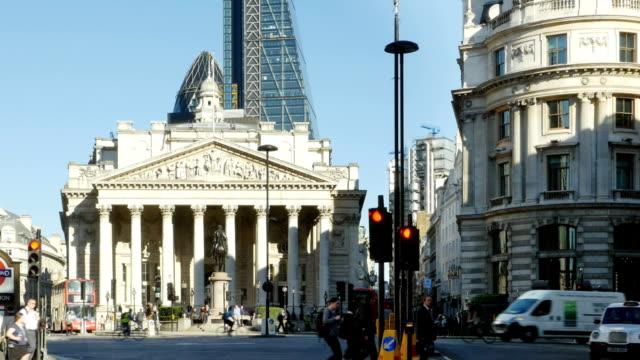 traffic around royal exchange in london city - city of london stock videos & royalty-free footage